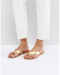 goldene flache Sandalen aus Leder von Asos