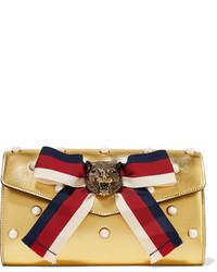 goldene verzierte Leder Clutch von Gucci