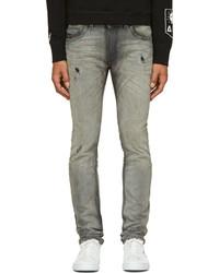 graue enge Jeans mit Destroyed-Effekten von Diesel