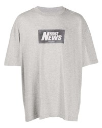 graues bedrucktes T-Shirt mit einem Rundhalsausschnitt von Maison Margiela