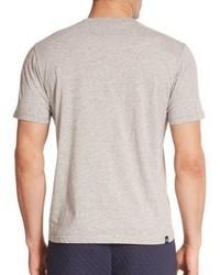 Graues T-Shirt mit Rundhalsausschnitt von Mostly Heard Rarely Seen