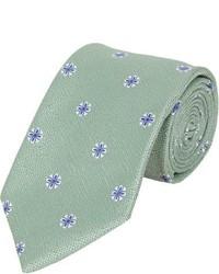 grüne Krawatte mit Blumenmuster