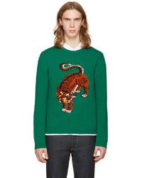 grüner bedruckter Pullover mit einem Rundhalsausschnitt
