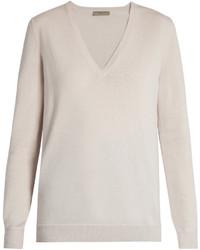 hellbeige Pullover mit einem V-Ausschnitt