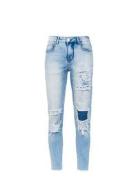 hellblaue enge Jeans mit Destroyed-Effekten von Amapô