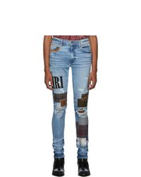 hellblaue enge Jeans mit Destroyed-Effekten von Amiri