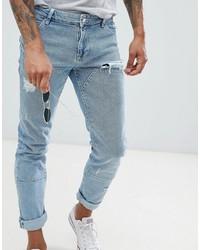 hellblaue enge Jeans mit Destroyed-Effekten von ASOS DESIGN