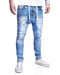 hellblaue enge Jeans mit Destroyed-Effekten von behype