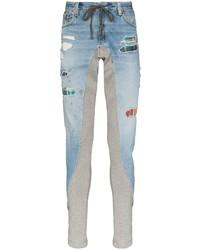 hellblaue enge Jeans mit Destroyed-Effekten von Greg Lauren