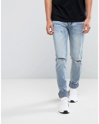 hellblaue enge Jeans mit Destroyed-Effekten von Sixth June