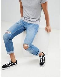 hellblaue enge Jeans mit Destroyed-Effekten von YOURTURN