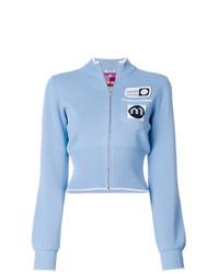 hellblauer Pullover mit einem Reißverschluß von Miu Miu