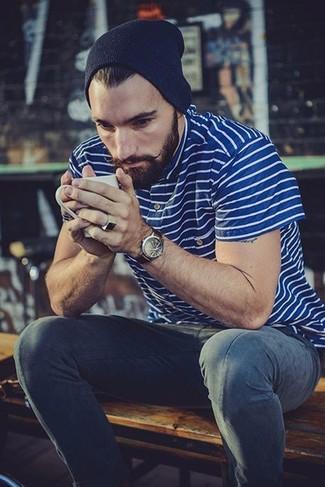 Wie kombinieren: blaues horizontal gestreiftes Polohemd, dunkelblaue Jeans, dunkelblaue Mütze