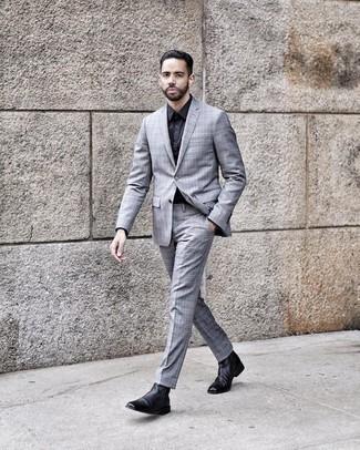 Dunkelblaues Businesshemd kombinieren: trends 2020: Erwägen Sie das Tragen von einem dunkelblauen Businesshemd und einem grauen Anzug mit Schottenmuster für einen stilvollen, eleganten Look. Suchen Sie nach leichtem Schuhwerk? Ergänzen Sie Ihr Outfit mit schwarzen Chelsea Boots aus Leder für den Tag.