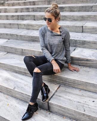 schwarze enge Jeans mit Destroyed-Effekten von J Brand