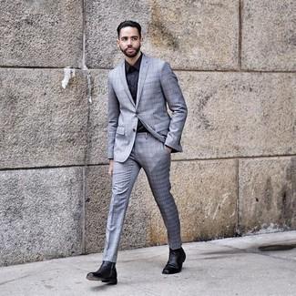 Dunkelblaues Businesshemd kombinieren: trends 2020: Tragen Sie ein dunkelblaues Businesshemd und einen hellblauen Anzug mit Schottenmuster für einen stilvollen, eleganten Look. Fühlen Sie sich ideenreich? Wählen Sie schwarzen Chelsea Boots aus Leder.