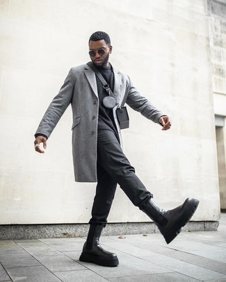 Schwarze Chelsea Boots aus Leder kombinieren – 500+ Herren Outfits: Kombinieren Sie einen grauen Mantel mit einer schwarzen Chinohose für Ihren Bürojob. Fühlen Sie sich mutig? Vervollständigen Sie Ihr Outfit mit schwarzen Chelsea Boots aus Leder.