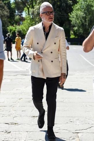Schwarzes Langarmhemd kombinieren: trends 2020: Vereinigen Sie ein schwarzes Langarmhemd mit einer schwarzen Chinohose für einen bequemen Alltags-Look. Fühlen Sie sich mutig? Komplettieren Sie Ihr Outfit mit schwarzen Chelsea Boots aus Wildleder.