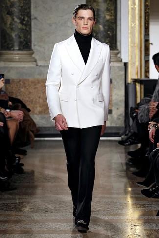 23a5aac8e64c Herrenmode › Herrenmode der 30er Jahre Entscheiden Sie sich für ein weißes  Zweireiher-Sakko und eine schwarze Anzughose für einen stilvollen
