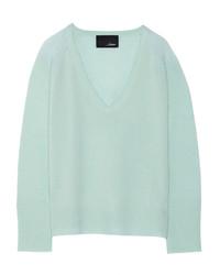 mintgrüner Pullover mit einem V-Ausschnitt