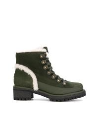 olivgrüne flache Stiefel mit einer Schnürung aus Wildleder von Tory Burch