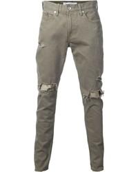 olivgrüne Jeans mit Destroyed-Effekten
