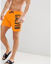orange bedruckte Badeshorts von Calvin Klein