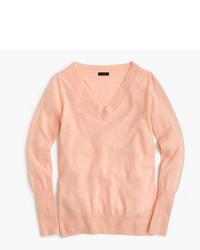 rosa Pullover mit einem V-Ausschnitt