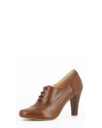 rotbraune Schnürstiefeletten aus Leder von Evita