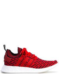 rote Turnschuhe von adidas