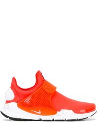rote Turnschuhe von Nike