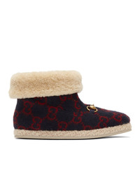 rote und dunkelblaue Ugg Stiefel von Gucci