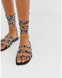 schwarze bedruckte Römersandalen aus Leder von ASOS DESIGN
