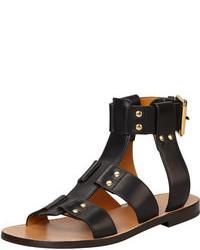 schwarze beschlagene flache Sandalen aus Leder