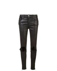 schwarze enge Jeans mit Destroyed-Effekten von Amiri