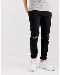 schwarze enge Jeans mit Destroyed-Effekten von ASOS DESIGN