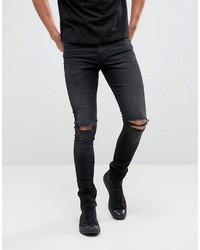 schwarze enge Jeans mit Destroyed-Effekten von Asos