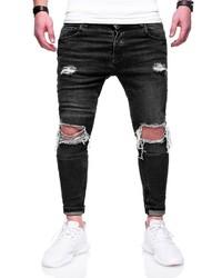schwarze enge Jeans mit Destroyed-Effekten von behype