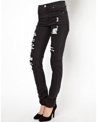 schwarze enge Jeans mit Destroyed-Effekten von Cheap Monday