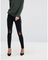 schwarze enge Jeans mit Destroyed-Effekten von Dr. Denim