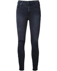 schwarze enge Jeans mit Destroyed-Effekten