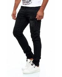 schwarze enge Jeans mit Destroyed-Effekten von KINGZ