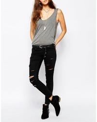 schwarze enge Jeans mit Destroyed-Effekten von Only