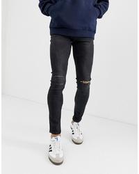 schwarze enge Jeans mit Destroyed-Effekten von ONLY & SONS