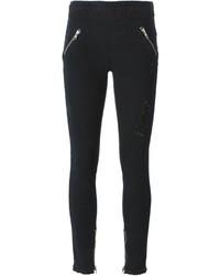 schwarze enge Jeans mit Destroyed-Effekten von RtA