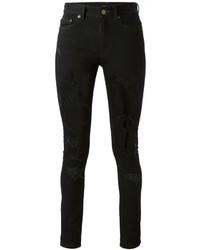Schwarze Enge Jeans mit Destroyed-Effekten von Saint Laurent