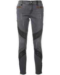 schwarze enge Jeans mit Destroyed-Effekten von Versace