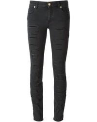 schwarze enge Jeans mit Destroyed-Effekten von Versus