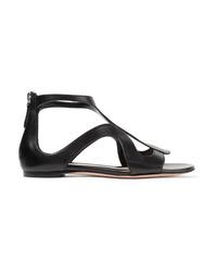 schwarze flache Sandalen aus Leder von Alexander McQueen