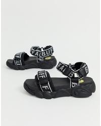 schwarze flache Sandalen aus Leder von Buffalo